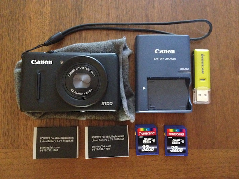Canon S100 camera, spare batteries, memory cards, and card reader