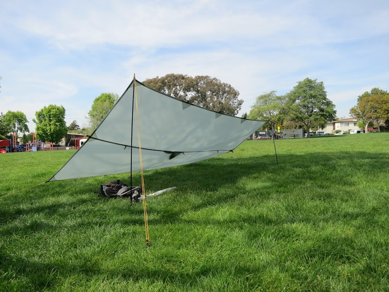 Tarp in lean-to setup with asymmetrical pole heights.