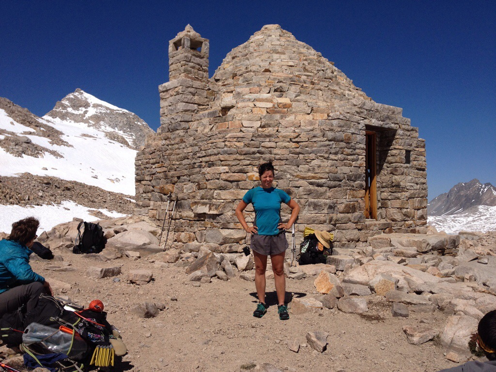 Alice and the summit hut on top of Muir Pass.