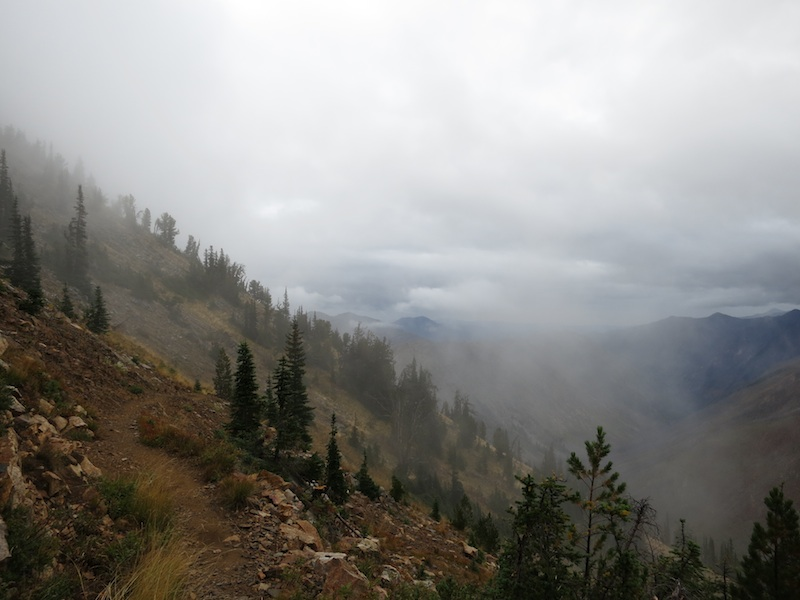 trail through the mountains with low-lying clouds