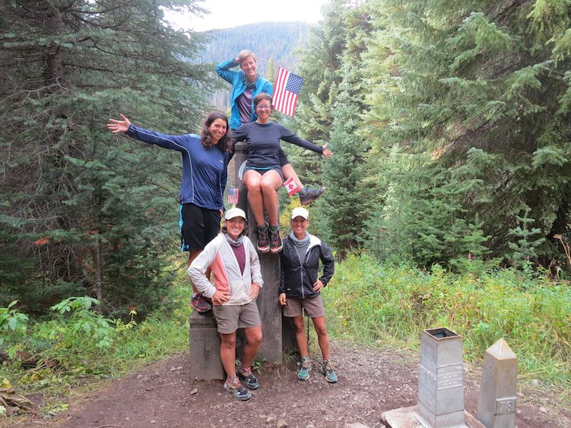 five hikers (Mozzie, Penguin, Starboard, Port, Emu) at the monument at the end of the PCT