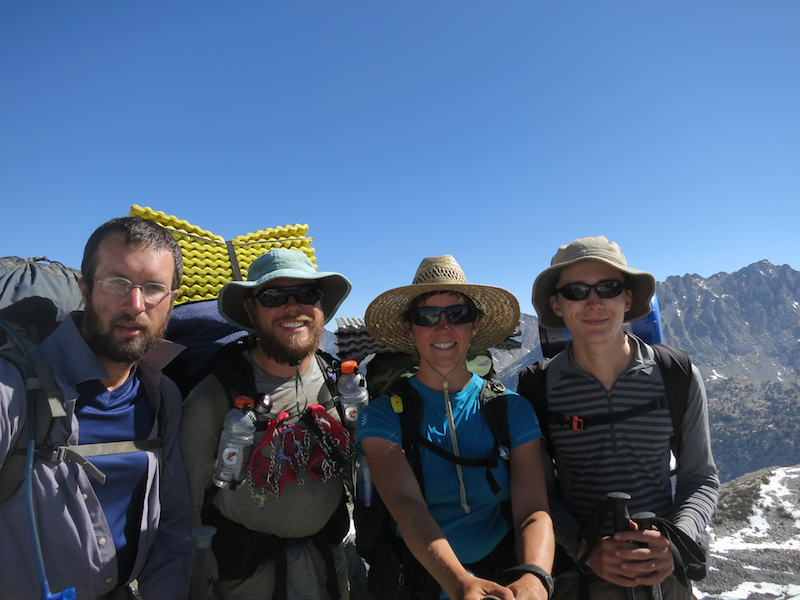 Atop Glen Pass, wearing the wrap-around polarized sunglasses, with Big Boots, Jordi, and Sock Pot.