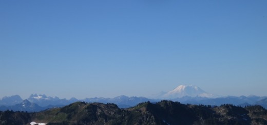 mt. rainier in front of a ridgeline