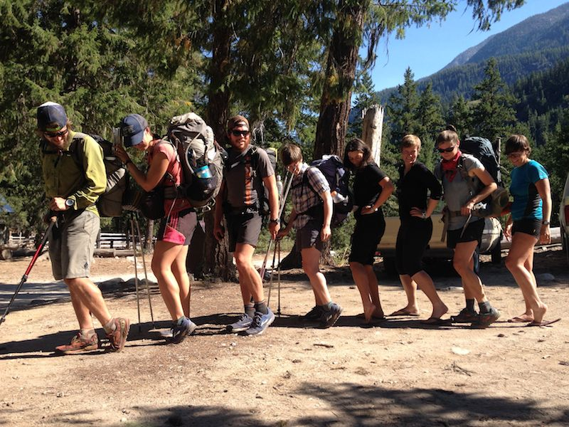 PCT hikers at the Stehekin bus stop showing off calves